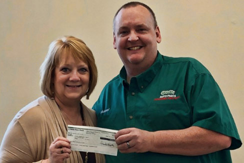 O'Reilly Auto Parts Manager Mike Vannest makes a donation to Karin Bright